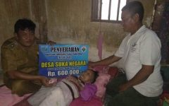 Nursini Gunakan Uangnya untuk Beli Obat, BLT Dana Desa Cair Langsung Diantar Kades Suka Negara